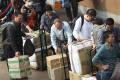 Parallel traders wait outside the Sheung Shui MTR station. Photo: Sam Tsang