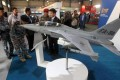 Military officials looking at a model of a FA-50 fighter jet. Manila will soon finalise a US$443 million deal to buy 12 of the jets. Photo: AFP