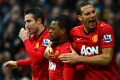 Patrice Evra (centre) and his United teammates at a match at Old Trafford in Manchester last month. Photo: AFP