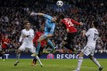 Real Madrid's goalkeeper Diego Lopez (centre left) duels for the ball with Manchester United's Shinji Kagawa. Photo: AP