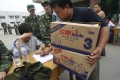 A Chinese man carrying two boxes of tainted milk formula for refunds in 2008 when more than 6,000 babies were affected. Photo: AP