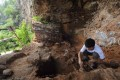 An archaeologist explores the Zhoukoudian Caves in Beijing, which have yielded Peking Man and Tianyuan Man. Photo: SMP