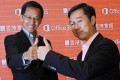 William Yeung of HKBN and Horace Chow of Microsoft celebrate the joint launch of the Office 'cloud' service in the city. Photo: Edward Wong