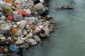 Rubbish clogs up a polluted canal on the edge of Beijing. Photo: AFP