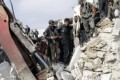 People search for survivors among the rubble after a Syrian army rocket attack on the rebel-held Jabal Badro district in the city of Aleppo. Photo: Reuters.