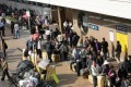 Parallel traders carry their goods at Sheung Shui train station. Photo: Edward Wong