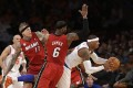 Carmelo Anthony of the New York Knicks (right) looks to pass as Chris Andersen and LeBron James defend. Photo: AP