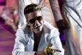 Justin Bieber performs at London's O2 Arena. Photo: AP