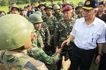 Malaysian Prime Minister Najib Razak (right) meets Malaysian soldiers at Felda Sahabat, Borneo, in Malaysia's Sabah state, on Thursday. Photo: EPA