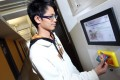 Andy Fong checks his power consumption at Lee Woo Single College hostel. Photo: Nora Tam
