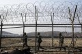 South Korean army soldiers patrol along a barbed-wire fence at the Imjingak Pavilion near the border village of Panmunjom. Photo: AP