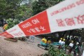 Workers setting up a cordon around the empty site at Pai Tau village. It has been used as a car park. Photo: Sam Tsang