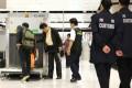 Customs officers inspect luggage at Lok Ma Chau. Photo: Edward Wong