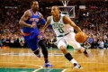 Avery Bradley #0 of the Boston Celtics drives to the basket past J.R. Smith #8 of the New York Knicks during the game  at TD Garden in Boston, Massachusetts. Photo: AFP