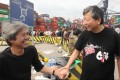 Lawmaker Lee Cheuk-yan (right), who is also head of the Confederation of Trade Unions, shows support to workers have gone on strike for a second day at the Kwai Chung container terminal in a dispute over pay. Photo: Edward Wong