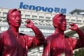 A Lenovo logo seen behind a sculpture at the company's office in Shanghai on 15 January, 2009. (Photo: EPA)