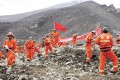 Rescuers search for survivors at the site of a landslide in a mining area in Maizhokunggar County, Tibet Autonomous Region. Photo: Reuters