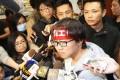 Union of Hong Kong Dockers spokesman Stanley Ho Wai-hong (centre) talks to the press on Thursday. Photo: Edward Wong