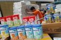 Tins of milk powder found in the warehouse. Photo: David Wong