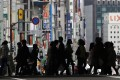 The Bank of Japan's balance sheet expansion plans are modest compared with those in the US and Britain. Photo: Reuters