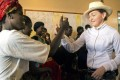Madonna greets Mphandura orphanage volunteers near Lilongwe last week. Malawi has criticised her for seeking VIP treatment. Photo: AP