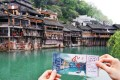 A visitor is holding an entry ticket in Fenghuang old town. Photo: Xinhua