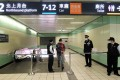 A passanger walks through Taoyuan High Speed Rail Station on Friday after suspected explosives and triggering devices were found on a train. Photo: AFP