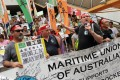 Australian unionists join local strikers in a march from the Kwai Tsing port to the Labour Department's office in Kwai Chung. Photo: K. Y. Cheng