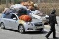 South Korean cars, carrying sacks of clothes made in the Kaesong joint industrial complex, arrive at the border city of Paju. Photo: AFP
