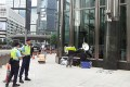Police officers stand by outside Cheung Kong Center in Central on Wednesday. Photo: Joyce Man