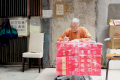 Pun Tse-ching writes letters for people in his neighbourhood.