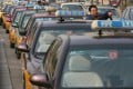Taxi drivers queue up at a taxi stand at a shopping area in Beijing. Photo: SCMP