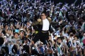 "South Korean rapper Park Jae-sang (centre), better known as PSY, performs during a live stream of the world premiere of his new single ""Gentleman"" at the Seoul World Cup Stadium in Seoul. Photo: Xinhua"