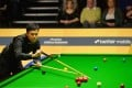 Marco Fu lines up a shot against Matthew Stevens of Wales. Photo: AFP