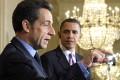 President Barack Obama listens with former French President Nicolas Sarkozy in Washington. Photo: AP