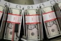 The Federal Reserve may have more scope to increase supply of US dollars as inflation shows little sign of picking up. Photo: Bloomberg