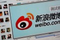 Alibaba would be looking to offer its popular e-commerce services to Sina Weibo's 500 million registered users. Photo: Reuters