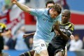Chelsea's Ramires (right) in action against James Milner (left) of Manchester City during the English FA Cup semi final soccer match. The English FA is now searching for the living descendants of the founding fathers of football