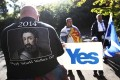 Pro-independence supporters take part in a rally in Princes Street gardens in Edinburgh. Photo: Reuters