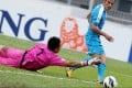 Kitchee's Pablo Gonzalez takes on Warriors' goalkeeper Hassan Abdullah Sunny in an AFC Cup match at Mong Kok Stadium. Photo: Sam Tsang