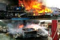 Stilt houses at Tai O village are engulfed in thick smoke and fierce flames yesterday. Photos: SCMP