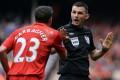 Jamie Carragher argues with the referee. Photo: AFP