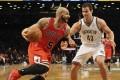 Chicago Bulls forward Carlos Boozer (left) drives around Brooklyn Nets' Chris Humphries. Photo: EPA