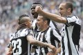 Juventus' Arturo Vidal (left) celebrates with teammates after scoring a penalty against Palermo during their Italian Serie A soccer match at the Juventus stadium in Turin on Sunday. Photo: Reuters
