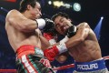 Manny Pacquiao trades blows with Juan Manuel Marquez during their WBO world welterweight fight last December. Photo: AP