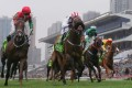 Race 8, Dan Excel(middle), ridden by Weichong Marwing, won the Champions Mile(HK Group 1, 1600m) at Sha Tin. Photo: Kenneth Chan