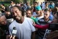 Charles Ramsey speaks to media outside his home.