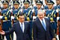 Chinese Premier Li Keqiang (left) walks with visiting Israeli Prime Minister Benjamin Netanyahu during a welcoming ceremony at the Great Hall of the People in Beijing, on Wednesday. Photo: EPA