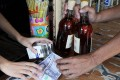The Philippines has banned people from carrying large amounts of cash and buying alcohol in controversial efforts to curb rampant vote buying and violence ahead of elections next week. Photo: AFP