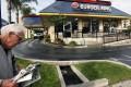 A pedestrian walks past a Burger King restaurant near downtown Los Angeles. Photo: AP